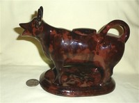 Jackfield-type mold cow creamer with Rockingham glaze