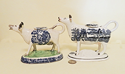 2 Blue Willow teransfer printed cow creamers, left