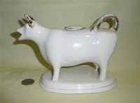 White cow creamer with gilt