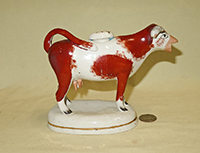 Reddish-br spotted and orange nosed Swansea cow creamer