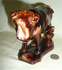 Treacle Glaze cow creamer with milkmaid, front