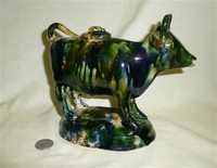 Green glazed cow creamer, riight