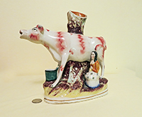 Large spill vase cow creamer with standing milkmaid