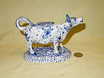 Long necked cow creamer with blue flowers, right