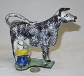 Blackish sponge painted  cow creamer