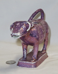 Purple lustre cow creamer, front