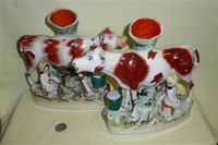 Pair of large cow creamer spill vases with sitting milkmaids