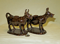 Pair of Rockingham glazed cow cxreamers similar to those with Jackfield glaze, side