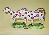 Pair of Swansea Cambrian cow creamwers, side