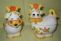 Orange nosed cow caricature creamer and sugar