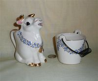 Napco Japan cow creamer and sugar bucket