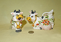 Cow creamer and sugar with flowers and yellow noses