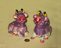 Purple Thames cow creamer and sugar with S&P heads