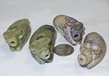Four small Chinese soapstone suiteki of water buffalo