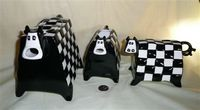 Rectangular shaped cow caricature teapot set with checkerboard design