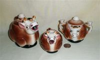 Small brown and white cow teapot set