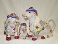 Lady cows with pearls and fancy hats teapot set