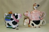 Cow tea for one and cow-pig-rooster stack teapots