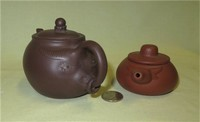 Two small Chinese yixing clay cow teapots