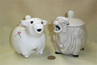 One winsome and one strange cow teapot