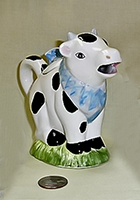 Small cow teapot with blue bandanna