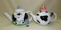 Teapots with cow head on front and on top