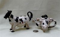 Two small fake collector's cow teapots by Nini