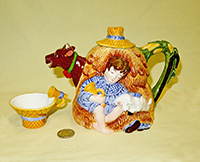 Boy asleep in haystack cow teapot with cups
