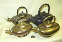Four Indian cow headed ghee pots