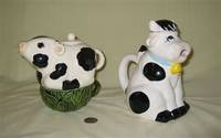 2 Black and white cows