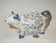 Chinese ceramic cow teapot with blue trim and pink flowers