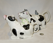Two lying down cow teapots