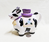 Cow teapot with purple hat lid