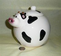 Spherical cow teapot with tiny horns