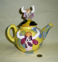 Homemade teapot with bull heads, right