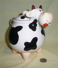 Bulbous nosed cow teapot with pointy legs
