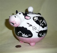 Caricature black and white cow teapot with simple flowers