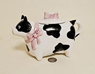 Pointy nosed cow teapot with pink bows