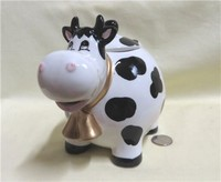 Chubby caricature cow teapot with big nose and double bell