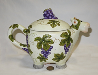 cow teapot with grapes and leaves, side
