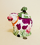 purple spotted cow teapot with tree on top