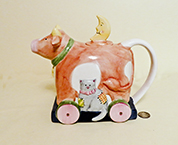 Susan Winget cow on wheels with cat teapot