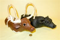 Christy Crews Dunn longhorn and Angus cow teapots