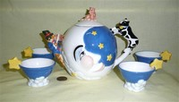 Dept 56 cow overv the moon teapot set, front