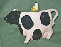 Andy Titcomb cow with milk bottle teapot
