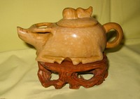 Smnall brown stone Chinese water buffalo teapot on wooden stand