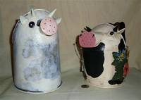 2 cow watering cans