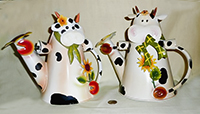 2 flowery cow watering cans